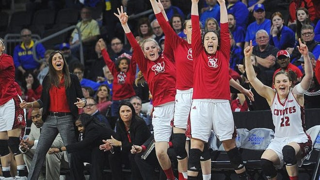 The USD women celebrate a basket in the Summit League tournament