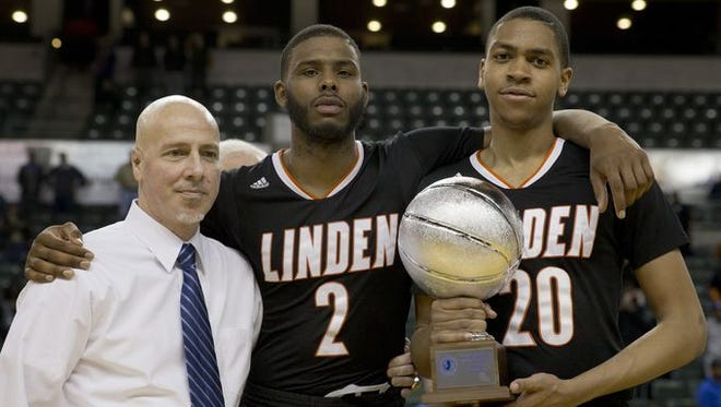 Linden coach Phil Colicchio with players Fritz Moncion and William Phelps.