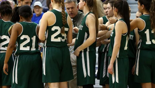 Keith Lane coaches his team as East Brunswick took on Monroe in the GMC finals on Feb 25.