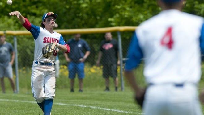 St. Clair freshman Ian Janssen throws the ball to first during a Division 2 baseball regional Saturday, June 6, 2015 at Armada High School.