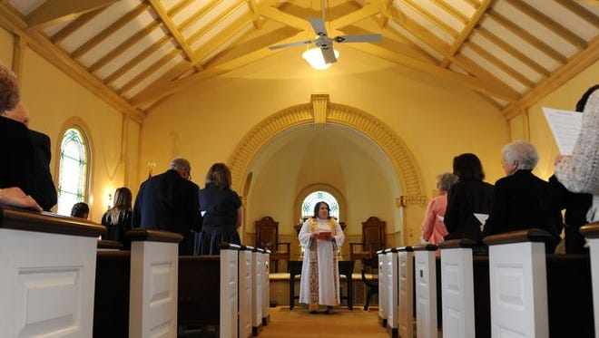 Charlotte Elia concludes the final church service at Belle Haven Presbyterian Church on Easter Sunday, March 27, 2016. The church began in 1879. The church elders elected to close the church due to its aging and dwindling membership.