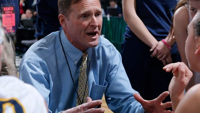 Haslett coach Bob Currier talks to his players during a timeout against Detroit Country Day in the MHSAA Class B championship game Saturday, March 21, 2015, at the Breslin Center in East Lansing, Mich. Haslett fell 49-41. Currier announced his resignation last week to school officials.