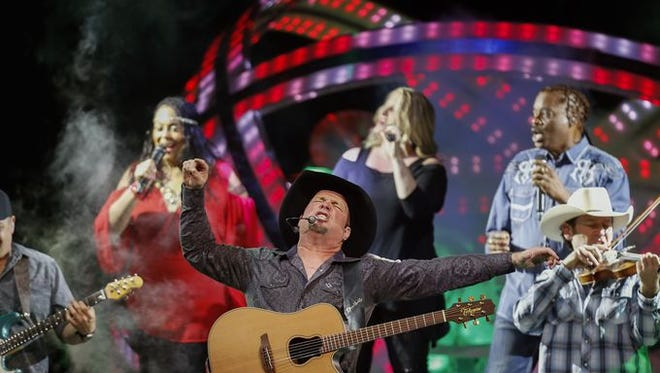 Garth Brooks performs for the crowd at the KFC Yum! Center on Friday evening.