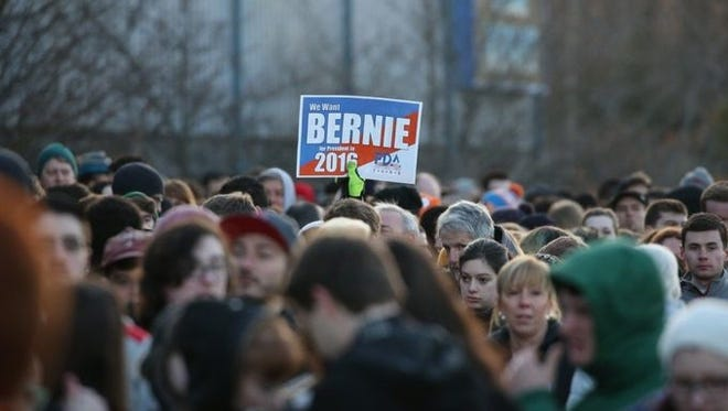 People wait in line to attend the Bernie Sanders rally Tuesday morning in Rochester.