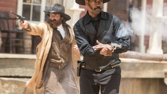 Director Antoine Fuqua brought Denzel Washington (front) to lead a new version of 'The Magnificent Seven.' in theaters Sept. 23.