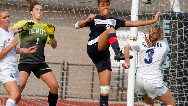 DeWitt's Brianna Bishop, center, and goalie Brooklyn Holley (1) defend against Richland Gull Lake's Mickey Hostetler (3) and Maddie Fouts, left, during their state semifinal game last season, June 9, 2015, at Grand Rapids Christian High School in Grand Rapids, Mich. DeWitt fell 1-0. Bishop is one of three returning Division 2 all-state performers for the Panthers in 2016.