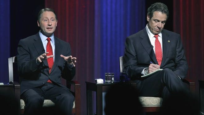 Westchester County Executive Rob Astorino and Gov. Andrew Cuomo attend a 2014 debate for governor in Buffalo