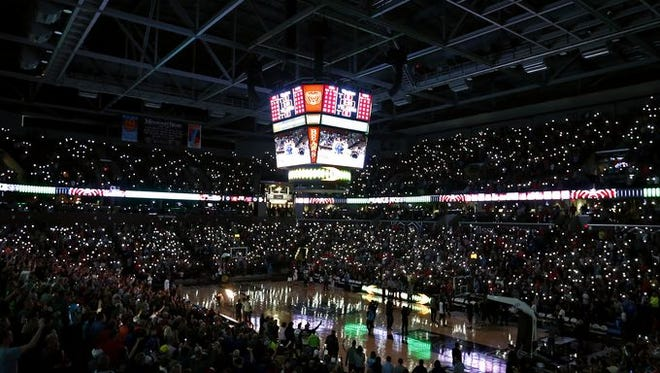 Fans use their cell phones to illuminate JQH Arena during player introductions for the final game of the 2016 Bass Pro Tournament of Champions.