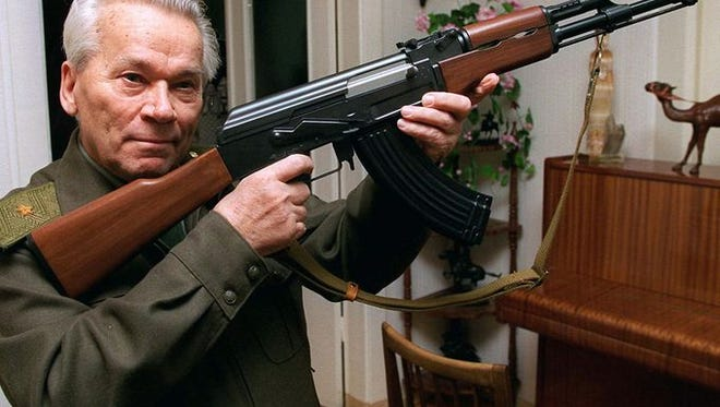 Mikhail Kalashnikov holds an AK-47, the assault rifle he invented, in this photo from 1997. Indianapolis police found a stolen AK-47 during a search of a suspect's home.