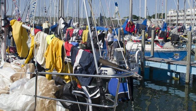 Clothes and sails dry on the booms of the boats after the Bayview race Monday.