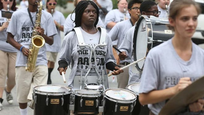 The Tech High School band marches in the 2014 Feast of Lanterns parade on the Near Eastside of Indianapolis.