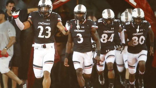 UC linebacker Eric Wilson (23) will join center Deyshawn Bond in representing the Bearcats at AAC Media Days.