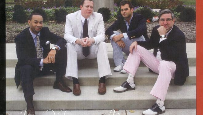 The new GOP candidate for governor, Eric Holcomb, poses on the right in pink pants.