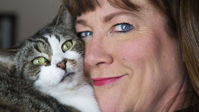 Janine Wagner of Irondequoit  has vowed to continue to feeding several feral and stray cats despite damage and removal of some makeshift homes she built for them in the city.