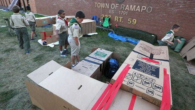 "Boy Scouts build a ""box city"" outside Ramapo Town Hall in August 2015 to simulate homelessness."