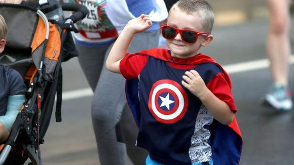 The second annual Asheville Running Experience Super Hero 5K brought out 150 runners Aug. 20.