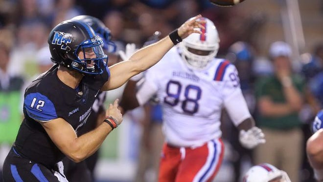MTSU quarterback Brent Stockstill throws the ball as Louisiana Tech defensive tackle Aaron Brown looks on in Saturday's loss to MTSU.