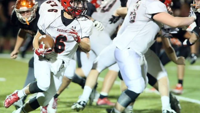 Coshocton wide receiver Andrew Kittell runs the ball on a sweep play against Meadowbrook.