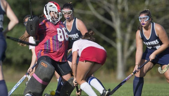 Wall's Emily Surgent hits the ball past Manasquan's goalie Dana DiLodovico in a Class B North game on Oct. 12, 2016.