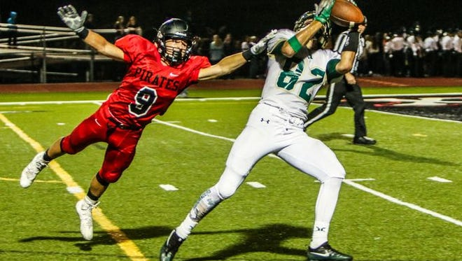 Howell's Logan Russo (82) caught two touchdown passes Friday night, pushing his season total to 10.