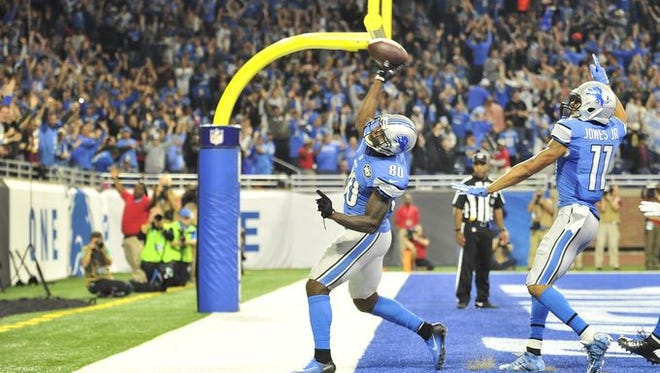 Anquan Boldin launches the ball into the crowd after scoring the game-winning touchdown.