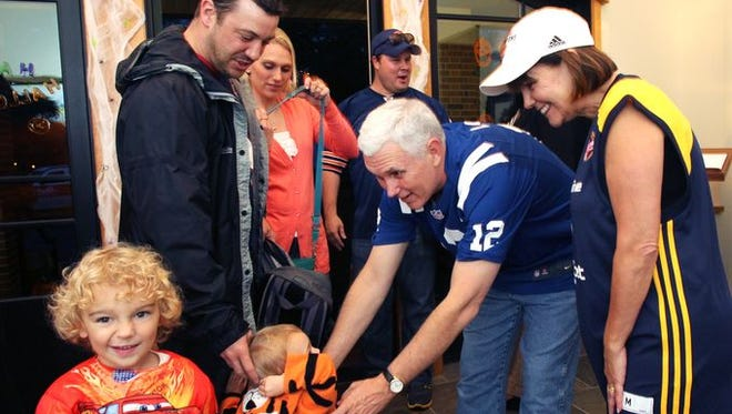 Mike and Karen Pence as Andrew Luck and an Indiana Fever player in 2013.