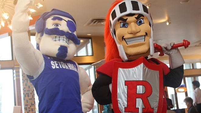 These mascots look happy. They have reasons.