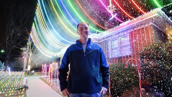 /File Dustin Pelletier poses amid his extravagant holiday light show in Taylors last year. Greer CPW customers won?t have to compete with him in chasing three $100 prizes for holiday lights this year. Pelletier isn?t a Greer CPW customer. Dustin Pelletier poses amidst his extravagant holiday light show in Taylors last year. Greer CPW customers won't have to compete with him in chasing three $100 prizes for holiday lights this year. Pelletier isn't a Greer CPW customer.