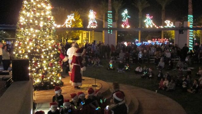 Santa and Mrs. Claus join with local residents at City Hall following the 2016 Mesquite Parade of Lights.
