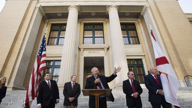 County commissioners Brian Hamman, Larry Kiker, Frank Mann, John Manning and Cecil Pendergrass in front of the Lee County Courthouse in Fort Myers.