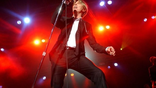 David Bowie performs during a concert in Kristiansand, Norway, in 2002. Celebrate the iconic performer more locally at Philadelphia Loves Bowie Week.