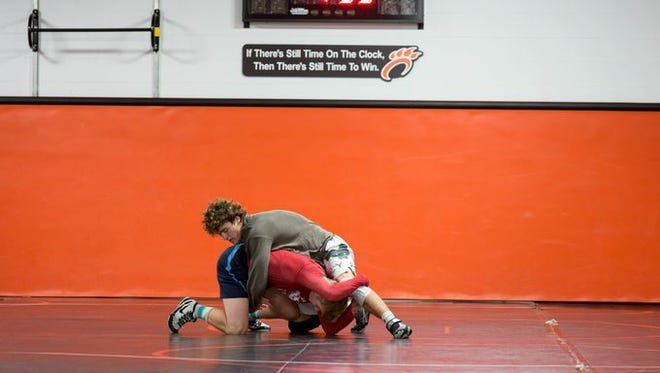 Stratford senior wrestler Mason Kauffman, top, works out during a recent practice. Kauffman overcame a life-threatening health issue to return to the mat this season.