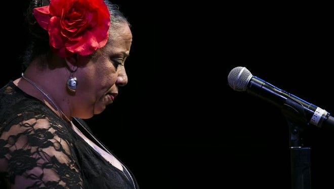 """Marilyn Omifunke Torres, faculty at South Mountain, tells her story to Arizona Storytellers """"Estamos Aqui/We Are Here"""" at South Mountain Community College Performing Arts Center in Phoenix, Ariz. on Thursday, March 31, 2016."""