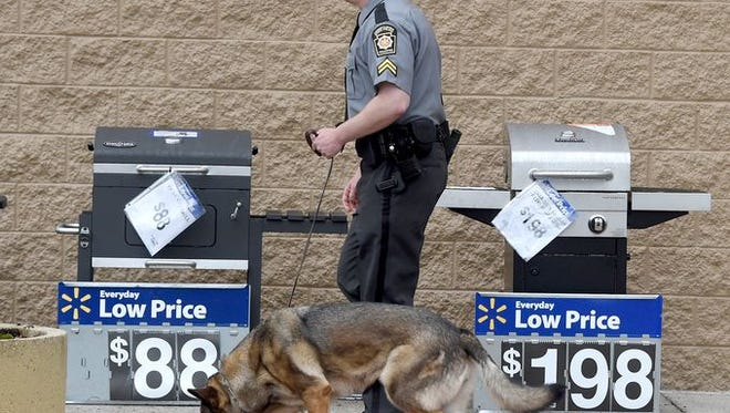 Bomb-sniffing dogs, similar to this one at the Shrewsbury Wal-Mart at a May 5 bomb threat, were called to the store Wednesday for another bomb threat. The threat was determined not to be real, police said.