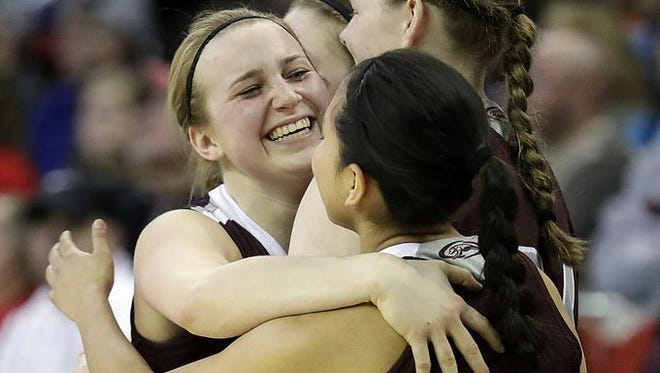 Loyal senior Morgan Reinwand celebrates with her teammates near the end of the Division 5 state championship game last Saturday.