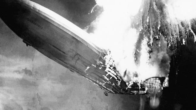 The Hindenburg explodes over New Jersey.
