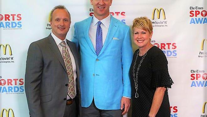 Kevin Hall, Peyton Manning and Judi Terzotis