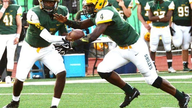 Captain Shreve's James Ivory takes the handoff in a game this fall. The senior leads the area in rushing.
