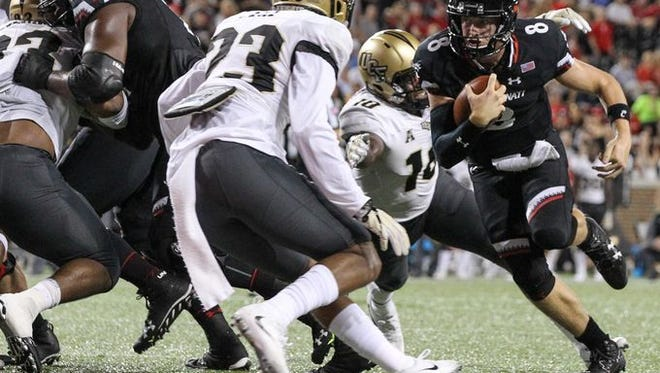 Cincinnati Bearcats quarterback Hayden Moore (8) rushed for two touchdowns in Saturday's 51-23 loss to Central Florida.