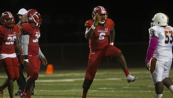 Immokalee defensive end Gonzalez Fleriot celebrates a sack during the Indians' recent 30-23 win over district rival Dunbar. Fleriot was recently selected to play in the Blue-Grey All-American Bowl in Tampa, a high school all-star game.