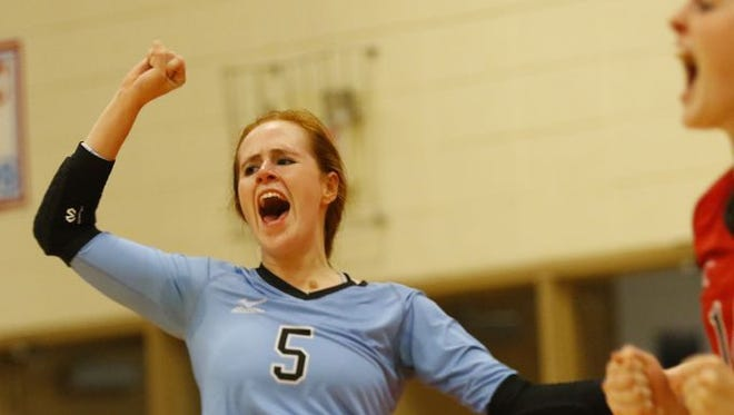 Newman Catholic libero Grace Ende celebrates a point in a match against Stratford earlier this season. The Cardinals face Clayton in a WIAA Diivisioin 4 state semifinal on Friday.