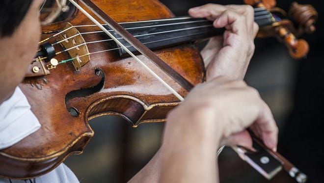Muncie Symphony Orchestra musician at ArtsWalk
