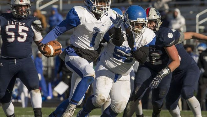Lakewood senior Zyheir Jones, shown running the ball against Lacey on Nov. 11, threw a touchdown  pass and had an interception return for a tTD Saturday in Lakewood's 46-25 loss at Woodrow Wilson in a NJSIAA Soutth Group III semifinal.