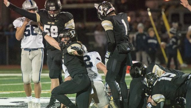 Point Pleasant Boro, shown celebrating a recovered fumble against Manasquan this past Friday in its 27-6 win in a NJSIAA Central Group II semifinal, moves up to No. 4 this week in the Asbury Park Press Top 10.
