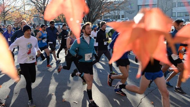 Nearly 2,000 runners and walkers took part in the 17th annual Asheville Turkey Trot 5K Nov. 23.