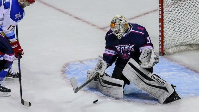 Ice Flyers goaltender Gordon Defiel makes a save on Roanoke's Matt Beer during the first period of Friday night's game. Roanoke scored four goals in the second period en route to 5-1 win.