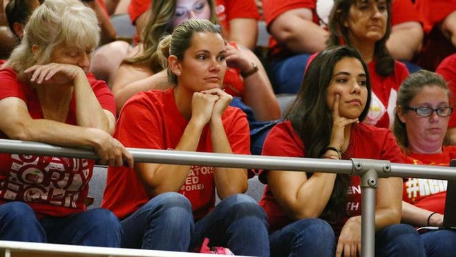 Jennifer Samuels, (center) a teacher running for Arizona House, was part of the #RedForEd movement that stormed the state Capitol. Here, she's photographed waiting for the Senate to debate education funding on May 2.