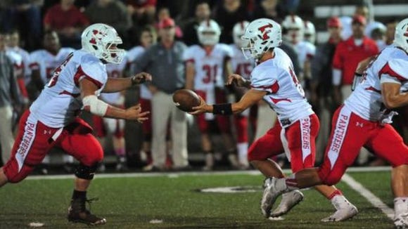 Jeremiah Young takes a handoff from Dalton Cochran during a game earlier this season.