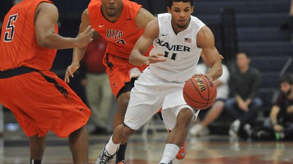 Dee Davis scored Xavier's final basket and finished with 12 points and five rebounds.