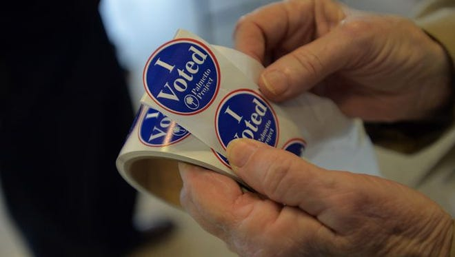 Voters cast their ballots at various Greenville County voting stations on Tuesday, Nov. 4, 2014.